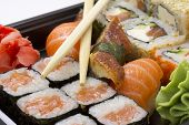 foto of masago  - Sushi bento box. Fresh sushi roll. Isolated.