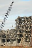 foto of wrecking  - wrecking ball demolition of ab abandoned building - JPG