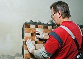 stock photo of ceramic tile  - Laying Ceramic Tiles - JPG
