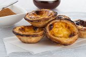 image of pasteis  - Closeup of delicious traditional asian dessert egg tarts - JPG