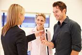 stock photo of start over  - Estate Agent Handing Over Keys To Office Space - JPG