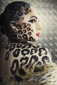 picture of leopard  - young sexy woman with leopard make up all over body - JPG