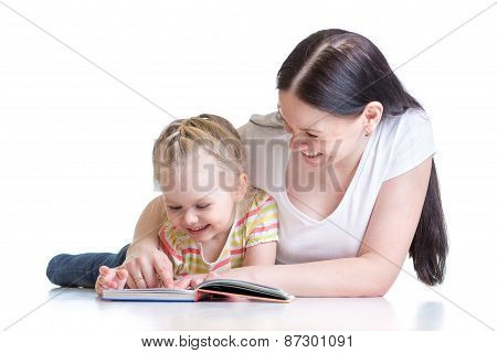 mother teaches reading book to child