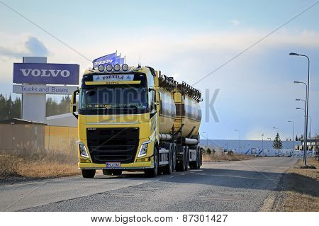 Yellow Volvo FH Tank Truck On The Road With Volvo Trucks Sign