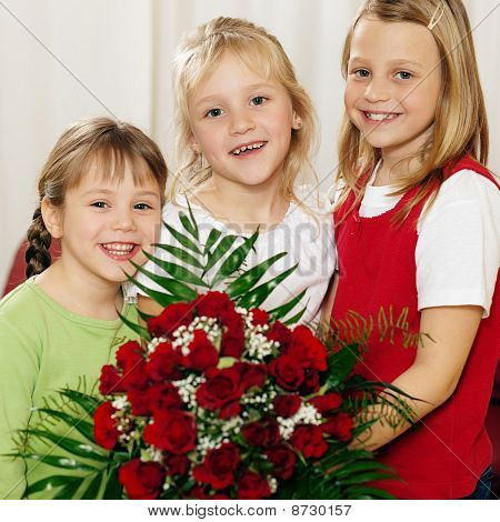 Children waiting with flowers for mother