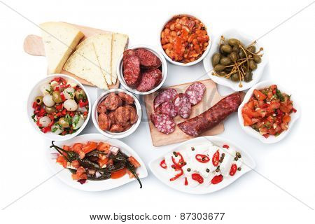 Tapas, antipasto or meze, mediterranean cold buffet food isolated on white background