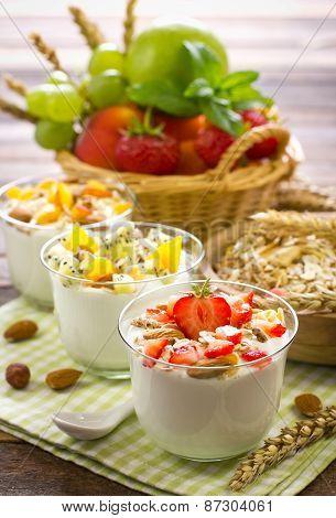 Healthy breakfast with yogurt granola and fruit