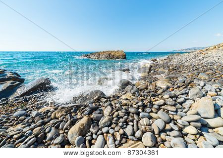 Pebbly Beach With Splashing Water
