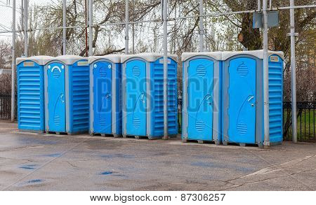 Row Of Portable Toilets On The Outdoor