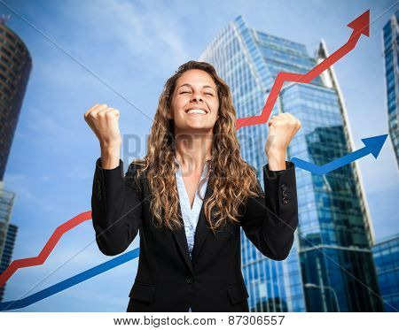 Portrait of a really happy businesswoman. Rising arrow in the background, representing business growth