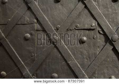 black wrought door in medieval castle