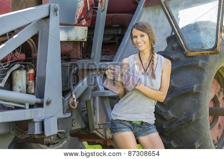 model posing as a farmers daughter in a rural environment