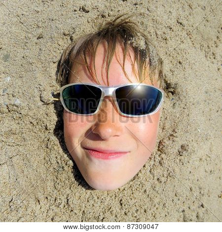 Teenager Face In The Sand