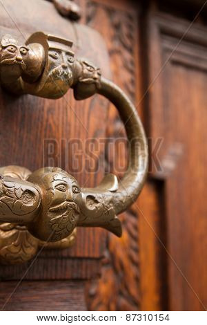 door handle on the door of an old building
