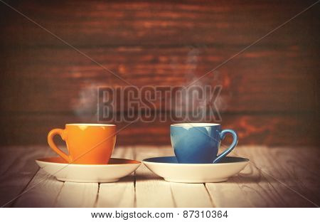 Two Cups Of Coffee On Wooden Table