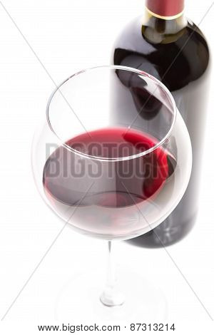 Wineglass With Red Wine And Bottle On White Background