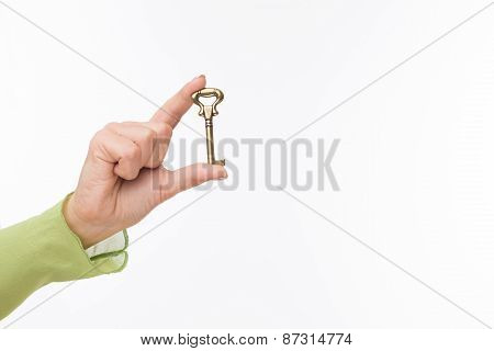 Hand with old key