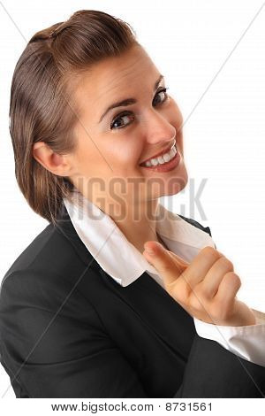 smiling modern business woman pointing finger at you isolated on white