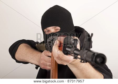 Man aiming at the target. Terrorism concept.