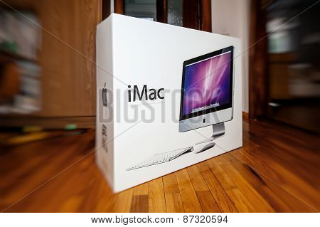 Apple Imac Computer In Box In Front Of Door