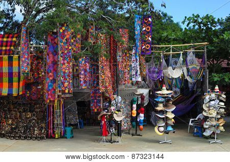 TULUM, MEXICO - NOVEMBER 11, 2014: Mexican Souvenirs In Improvised Open-air Shop in Tulum