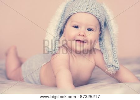 Portrait of a cute 6 months baby wearing rabbit hat
