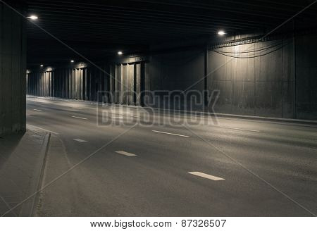Tunnel road area with spotlights on the wall