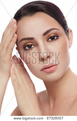 Portrait of young beautiful woman touching her face, over white background