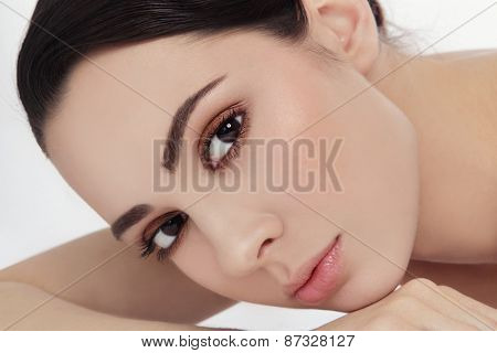 Close-up portrait of young beautiful woman with stylish make-up