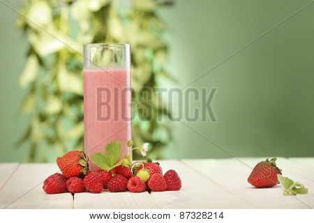 smoothie of berries on the table in the garden
