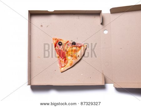 Slice of tasty pizza with ham and tomatoes in box, isolated on white background