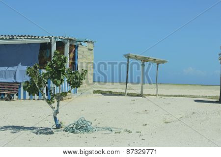 Humble House On The Beach.