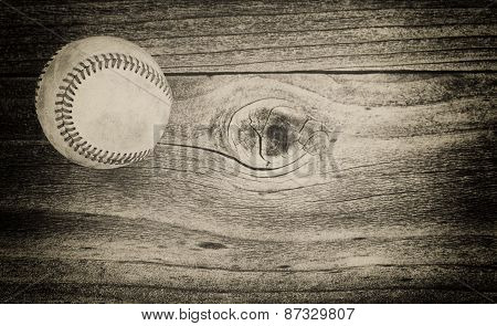 Used Baseball On Weathered Wood