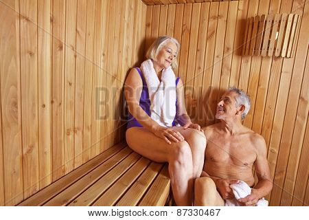 Senior people sweating in sauna of hotel in their holidays