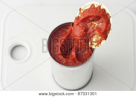 opened can of tomato paste