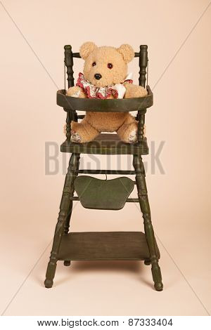 Stuffed self made bear sitting in child seat