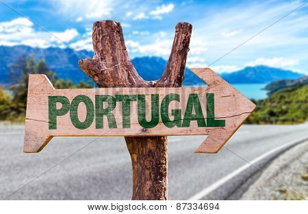 Portugal sign with road background