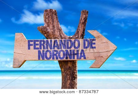 Fernando de Noronha wooden sign with beach background