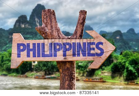 Philippines wooden sign with rural background