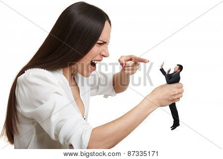 emotional yelling woman pointing at small scared man over white background