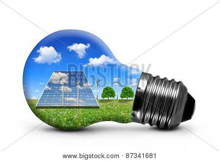 Solar panels and wind turbines in light bulb isolated on white background. Green energy concept.