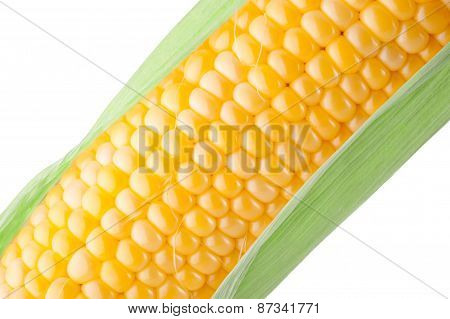 Corn On The Cob With Green Leaves Close-up On A White Background