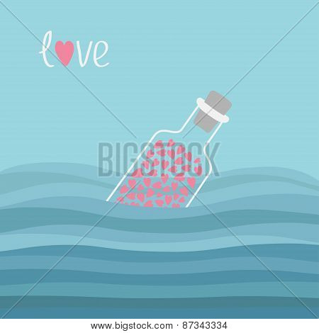 Wine Bottle With Hearts Inside In The Ocean Sea Water And Waves. Word Love Background.