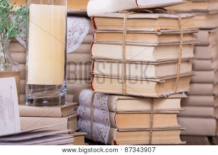 Old Book Heap And Candle