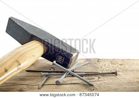 Hammer And Nails On Old Wood, White Background