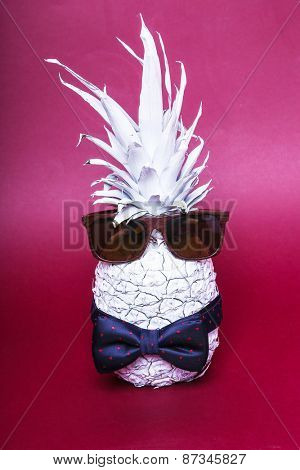 Bow tie on the white pineapple