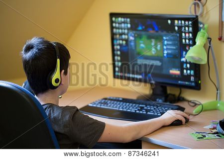 Boy Using Computer At Home, Playing Game
