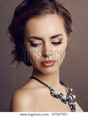 Girl With Dark Hair And Evening Makeup With Luxurious Necklace