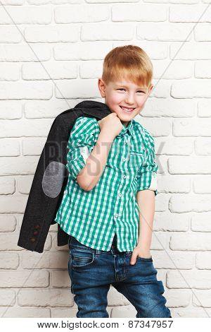 Happy little boy in jacket
