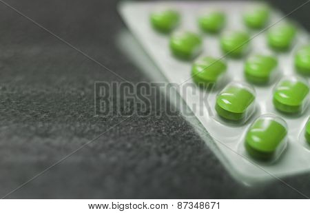 Blister pack of Green medicine pills Close up